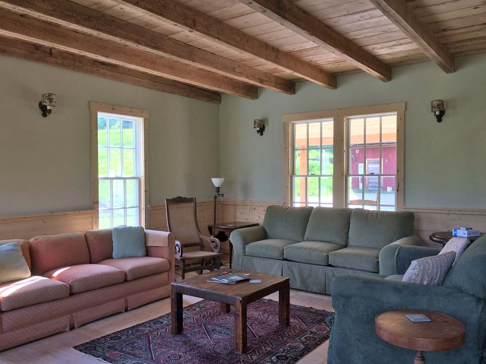 Farmhouse Living Room with two sofas and chair